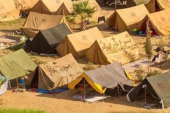 Displaced Christians in Erbil,look closely #68 has boldly written on the tent Jesus is the Light of the World #jesus http://t.co/5ZqMdFy030