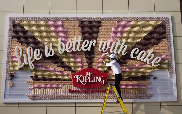 "Here is something that is definitely better with cake. Our poster being ""baked"" at Westfield #lifeisbetterwithcake http://t.co/xUlHzn5Dls"
