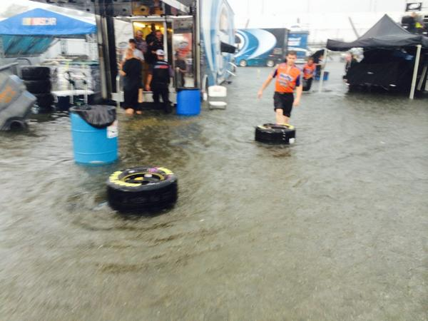 Ummm just a tad bit of flooding in the @NASCAR_NNS garage here @RIRInsider! Those tires FLOATED away!! http://t.co/1WuEMh2CLw