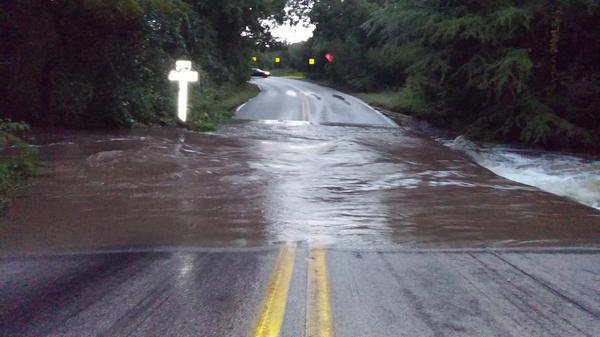 This is what the first low water crossing looks like on Spicewood Springs. Over a foot deep & 20ft wide. #ATXtraffic http://t.co/5E3Noy2fS7