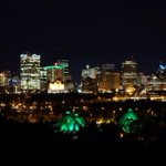 The @atbfinancial building lit up in Green and Gold. Muttart is green, as well. #UAlbertaAW http://t.co/bEYf3vmhmj