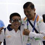 Indias Jitu Rai celebrates his gold medal with his coach Mohinder Lal #AsianGames live: http://t.co/IiBMhXPIV7 http://t.co/HVuxePkaKI
