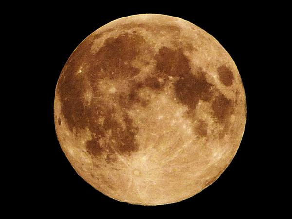 "The perigee fullmoon (""supermoon"" for some) a few minutes ago with a handheld camera - a bit hazy, thus the coloring. http://t.co/JUYcRnMZyJ"