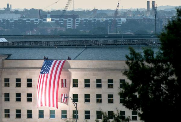 PHOTO: The American flag was unfurled along the Pentagon this morning in remembrance of the 9/11 attacks. http://t.co/LfLZEilttQ
