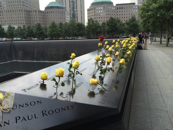 A tribute of yellow roses at the #911Memorial. #Honor911 #NeverForget http://t.co/47YFSpMVxX