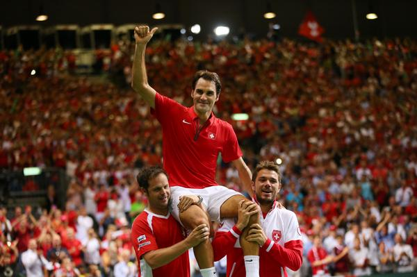 Thumbs up. @rogerfederer, @stanwawrinka and captain Luthi celebrate Switzerland's semifinal win over Italy #SUIITA http://t.co/KxjP8Ui6Kh