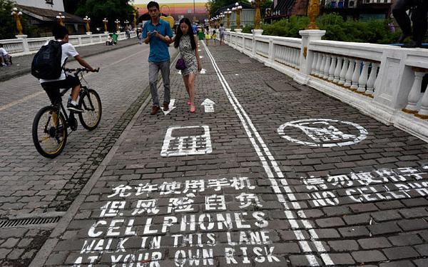 Chinese city paints street lane for mobile phone users - Telegraph   Found at http://t.co/fN9DLo6GTC http://t.co/dXQ9iPGXwu