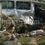 Foreign troops give first aid to foreign victims at the site of a suicide attack in Kabul. pic by me. http://t.co/GpxtJ1NKXv
