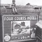 Watching the trains at Kingsbridge (Heuston) station ~ advert for the Four Courts Hotel on Inns Quay #Dublin http://t.co/eel8WjnXqR via Old