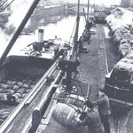 Dublin History ~ Loading and unloading the barges on the Guinness wharf Victoria Quay #Dublin @GuinnessIreland http://t.co/WMAdpqTT0W
