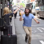 Happy weirdo spreads joy in New York City by high-fiving people waving for cabs. http://t.co/TM1GyYmTlk http://t.co/BUFhiQVKwi