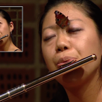 A butterfly landed on a classical flautist's nose during a music competition. http://t.co/qYMEY2F0pB http://t.co/Tp4zd81NJV