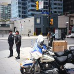 Two @OttawaPolice traffic officers at Rideau & Waller corner monitoring traffic for pedestrian/truck safety #ottnews http://t.co/cEgBur9xLp