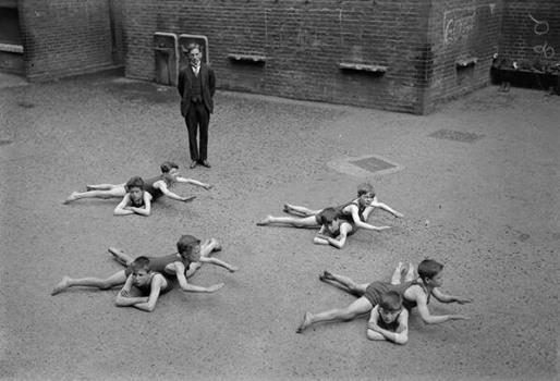 Children learn to swim in the schoolyard in England, early 1920s http://t.co/6QqBqwQXaS