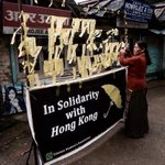 RT @JigmeUgen: A Tibetan woman ties a yellow solidarity ribbon for #HongKong #OccupyCentral #UmbrellaRevolution @OCLPHK #Tibet http://t.co/vhq7GaVx2E