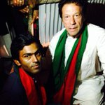 Imran Khan siting on ground outside his container to meet this boy who doesnt have legs http://t.co/gDU7jCljti