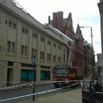 West Yorkshire fire crews working to clear the fire damage to the iconic old majestic building in Leeds city centre. http://t.co/i1d1aBj7Lf