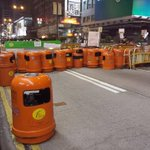 2332 #UMHK #live from Mongkok: Bins used as roadblocks … and a designated #cigarettes smoking spot. @OccupyHongKong http://t.co/Z2lu6R2DcD