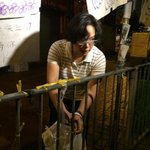 NEW: Woman cutting yellow ribbons on fences and is planning to cut banners from lampposts. @SCMP_News #OccupyCentral http://t.co/Omxe9Jcdzg