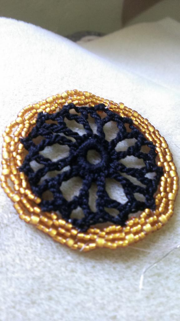 Playing with crochet and beading today.  Not sure where I am heading, but it is fun getting there. http://t.co/HYOP25UppH