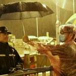 I love this photo. Democracy protester shields cop from rain with umbrella. So much for terrorists: http://t.co/RiEIDCnQIL #cdnpoli