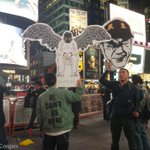 """""""Artist from @aiww group joined the #solidarity #HongKong #protest tonight at #timesquare #OccupyCentral #NY4HK http://t.co/IUyNbp7cMQ"""
