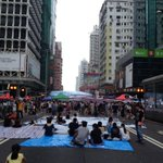 In occupied Mong Kok streets, it feels like protesters could erupt into yoga anytime. #OccupyCentral http://t.co/eWkiibgxOb