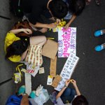Making yellow ribbons for universal suffrage near Central #umbrellarevolution #Occupycentral http://t.co/spcxFymea7