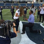 Seahawks cb Deshawn Shead proposing on the field after Seahawks beat Denver. http://t.co/HBbr6O0waC