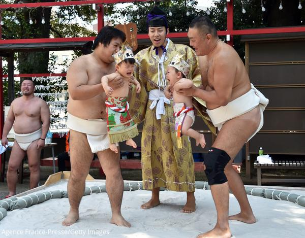 Sumo wrestlers hold babies during a competition in Japan and more photos from Asia today. http://t.co/QCU7MmLSny http://t.co/kmbpaftETs