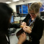 A team effort by morning producer @AmberZDuVal & @Phil_Sanchez to get @EileenVParks bracelet on. No one was injured http://t.co/FKOWxkD9sJ
