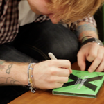 RT @nova919: Heres @EdSheeran signing one of the CDs YOU could win!!! Use #EdSheeranAndSmallzy to enter http://t.co/Hewk4UsZMX