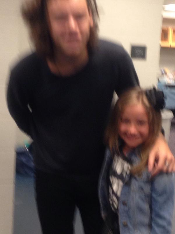Natalie Hanson (@natonthewall): I'm such a good mom because I just took this awesome photo of my daughter with Harry Styles