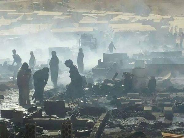 Syrian refugees gather whatever is left from their burnt tents in Ersal. Burnt by the Lebanese army. #Syria #Lebanon http://t.co/IpblVbi08h