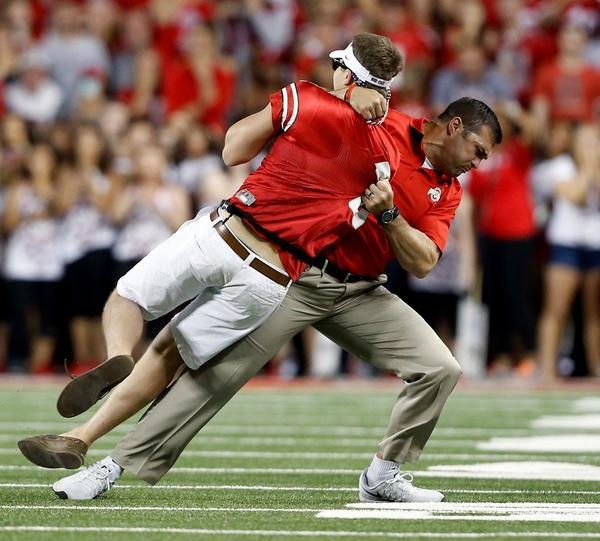 The photo of the Ohio State assistant slamming the guy who ran onto the field is majestic http://t.co/bqmp0PxV07