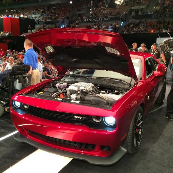 Amazing #BarrettJackson moment! The sale of the 2015 @Dodge #Challenger #Hellcat raised $825k for @OppVillageLV ! http://t.co/cjAQIj36Xn