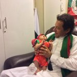 #AzadiSquare #Day46 - Chairman @ImranKhanPTI with one of the youngest #PTI supporters. Too cute! http://t.co/pFYJIDfmem