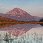 The magic & beauty of #wildatlanticway @ritawilsonphoto: Errigal Mountain starting to glow pink #donegal #Ireland http://t.co/1UECAjTSZJ