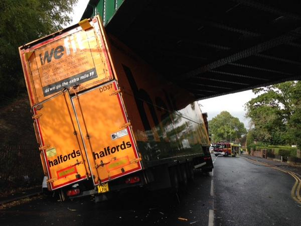 "Halfords Lorry With The Words ""We Fit"" On The Back Gets Stuck Under Bridge"