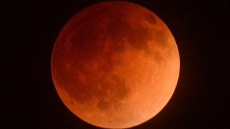 Moon glowing red as lunar eclipse peaks  http://t.co/X4Z2IhHf0i http://t.co/LKB6apuoMl