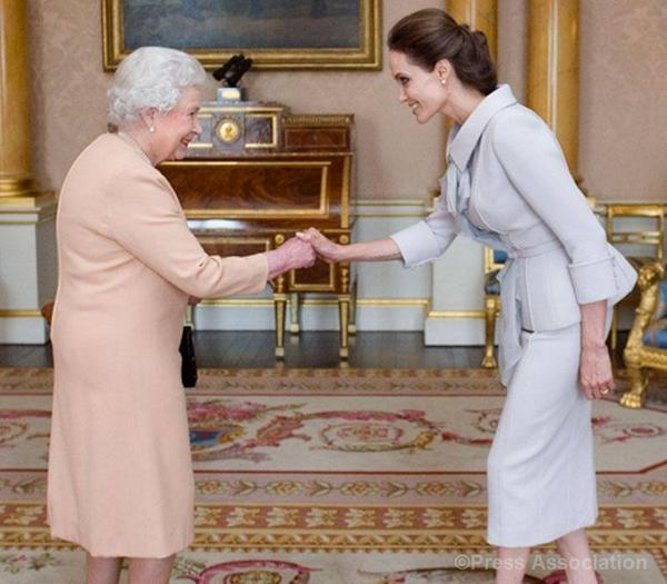 Queen Elizabeth presents actress Angelina Jolie as honorary dame for her work to end war-zone sexual violence. http://t.co/qU3ph7VIGn