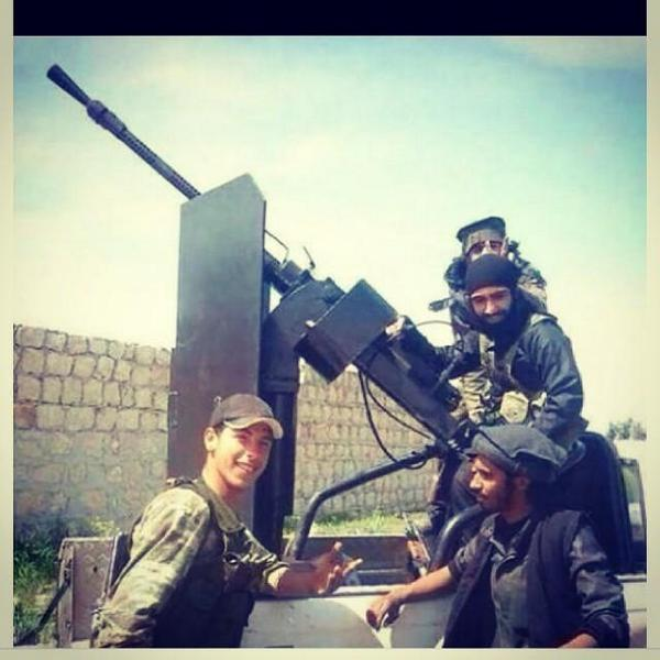 "A Turkish soldier ""visiting"" an ISIS anti-aircraft unit at Kobani. They look way too friendly. http://t.co/YtzcEYzuNn"