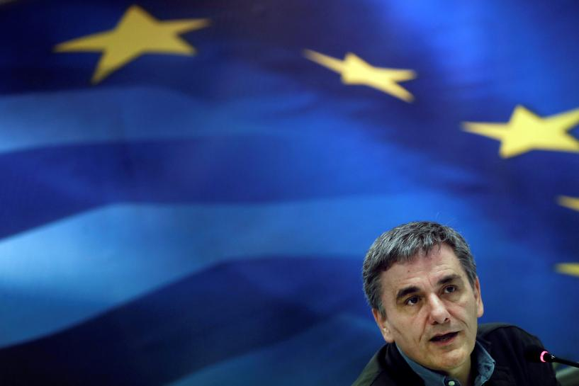 Pledging more austerity, Greece cuts deal with lenders