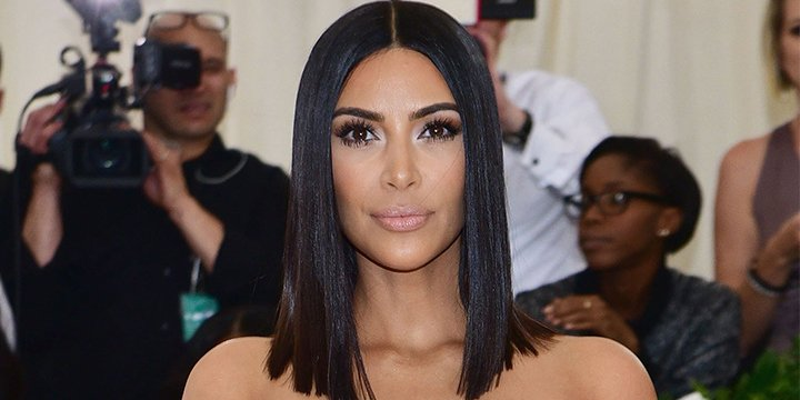 Kim Kardashian opens up about why Kanye West stayed home and skipped the