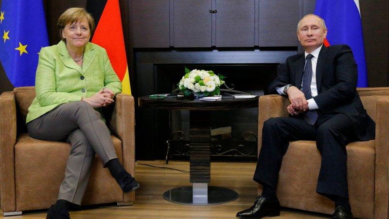 Vladimir Putin welcomes Angela Merkel to Sochi, for talks expected to include Ukraine, Syria