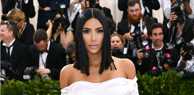 Kim Kardashian answers the big question at the Met Gala: Where's Kanye