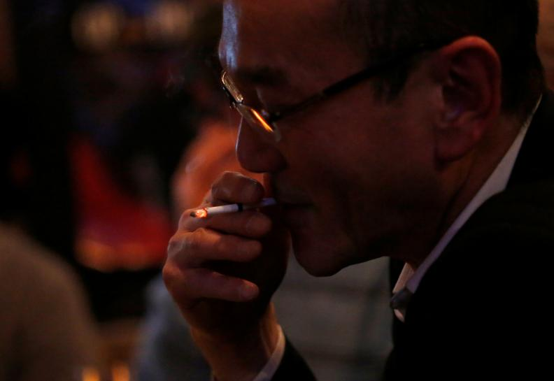 Japan wrestles over smoking ban as Olympics loom