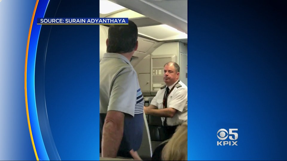 Cellphone video shows tense confrontation at SFO where a flight attendant and passenger nearly came to blows. https://t.co/KYLnfAkCp1