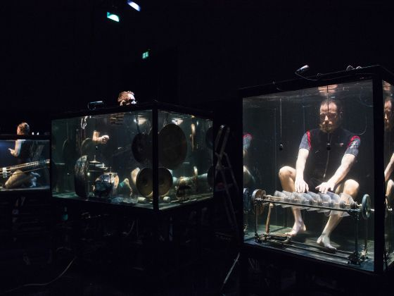 Musicians in aquariums make sounds in a silent world