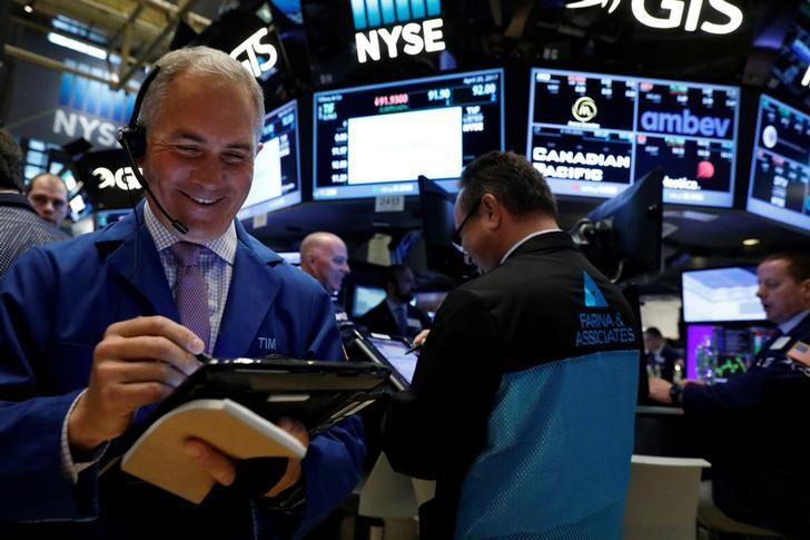 Wall Street surges, Nasdaq hits record on French vote result